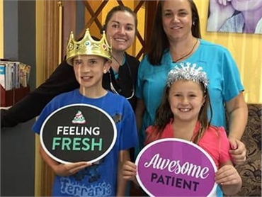 Longmont CO dentist Artistic Smiles team with patients