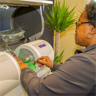 Stephanie using the cerec same day crowns machine at Waldorf dentist The Silberman Dental Group
