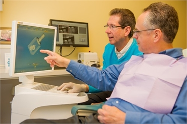 Waldorf dentist Dr. Paul B Silberman showing patient dental images at The Silberman Dental Group