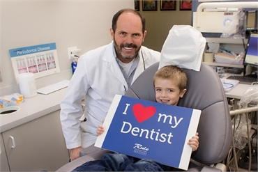 Gurnee IL dentist Bradley Rule DDS with young patient