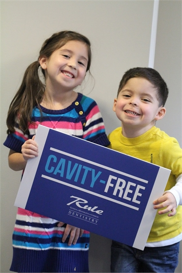 Young cavity free patients smiling with smiles at Gurnee IL dentist Bradley Rule DDS