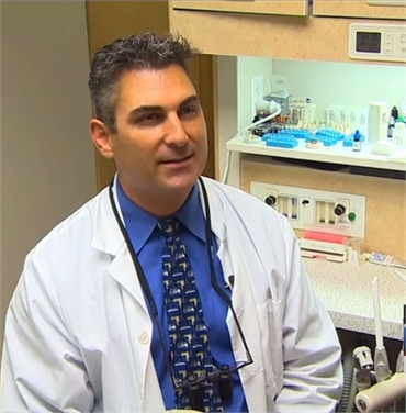 Dental implant specialist Dr. Timmerman at his office in Tukwila