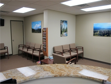 View of the waiting area from the front desk at implant dentistry Bancroft Family Dental Aurora